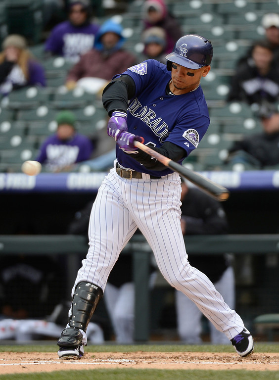 . Carlos Gonzalez of the Colorado Rockies hits a triple in the first inning against the New York Mets April 16, 2013 at Coors Field. Both teams wore the number 42 on their jersey in honor of Jackie Robinson. (Photo By John Leyba/The Denver Post)