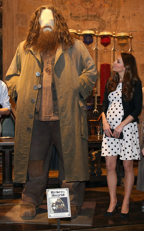 ". Britain\'s Kate the Duchess of Cambridge looks at the costume for the character Hagrid in the Harry Potter films as she and her husband Prince William and his brother Prince Harry, not pictured, attend the inauguration of ""Warner Bros. Studios Leavesden\"" near Watford, approximately 18 miles north west of central London, Friday, April 26, 2013. (AP Photo/Chris Jackson, Pool)"