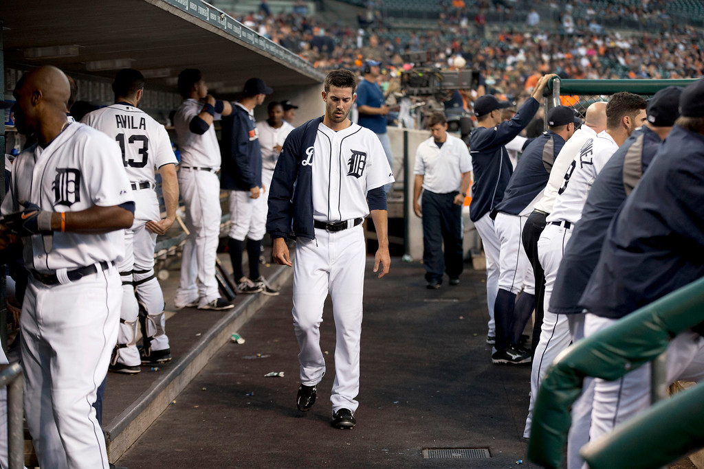 . Detroit Tigers pitcher Rick Porcello walks in the dugout against the Minnesota Twins in the first inning of a baseball game in Detroit, Friday, Sept. 26, 2014. (AP Photo/Paul Sancya)