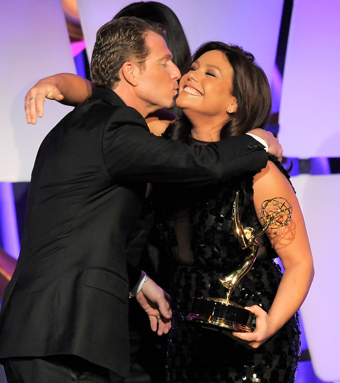 """. Rachael Ray, right, presents the culinary program award to Bobby Flay for \""""Barbecue Addiction\"""" onstage at the 39th Annual Daytime Emmy Awards on HLN at the Beverly Hilton Hotel on Saturday, June 23, 2012 in Beverly Hills, Calif. (Photo by Chris Pizzello/Invision/AP)"""