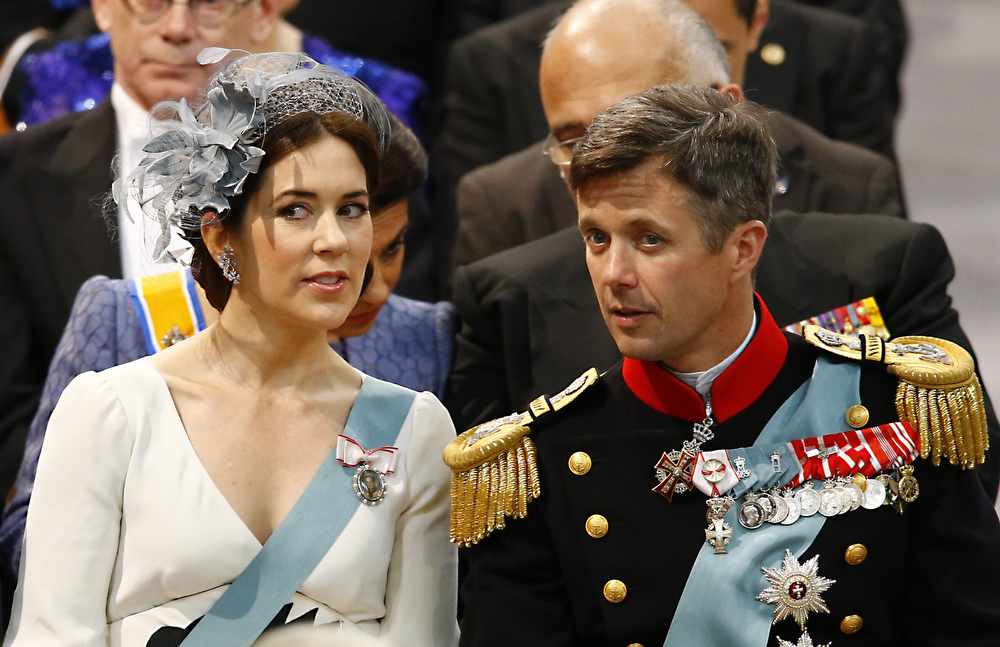 . Denmark\'s Crown Prince Frederik and Crown Princess Mary arrive at the Nieuwe Kerk or New Church in Amsterdam, The Netherlands, prior to the inauguration of King Willem-Alexander Tuesday April 30, 2013. Around a million people are expected to descend on the Dutch capital for a huge street party to celebrate the first new Dutch monarch in 33 years. (AP Photo/Michel Kooren, Pool)