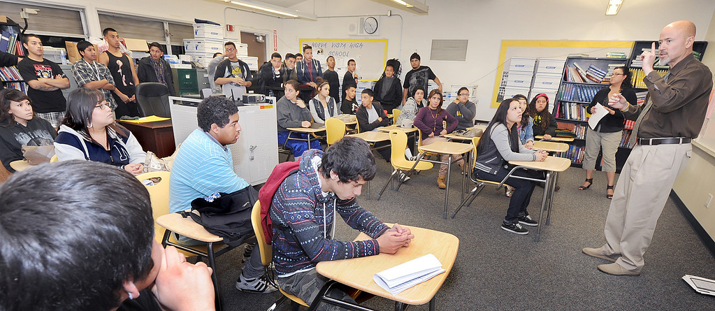 ". Former prinicpal of Nueva Vista High School and now Director of Curriculum & Instruction for Bassett Unified School Board addressing students concerns over the possible closing of their school and moving to Bassett High School. The Bassett Unified School Board at Thursday�s meeting will discuss relocating its Nueva Vista High continuation/alternative school back to the Bassett High campus in the 2013-14 school year in order to provide a more cohesive learning environment.  School board member Laura Santos is opposed to the plan since the district spent $1 million to renovate the Nueva Vista campus. It�s unclear what would become of that site. Santos held a  rally with parents and students who oppose the move  Wednesday, April 17, 2013. .""Along with losing an excellent superintendent and terminating an award winning choir and music program, Santos sees this as part of a series of recent bad decisions,\"" Santos said (SGVN/Photo by Walt Mancini)"