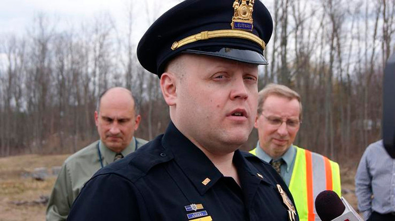 . Webster Police Lieutenant Mike Chiapperini briefs the media after an accident at the East Side Water Supply Project on Lake Road in Webster, New York in this April 12, 2011 file photo provided to Reuters December 24, 2012.  Chiapperini, also a volunteer firefighter, was killed when a gunman shot dead two firefighters and injured two others when he ambushed them at the scene of an early morning house fire in a suburb of Rochester, New York, authorities said on Monday. REUTERS/WebsterPost.com | Messenger Post Media/Files