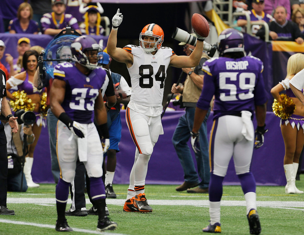 . Cleveland Browns tight end Jordan Cameron (84) celebrates after catching an 11-yard touchdown pass during the first half of an NFL football game against the Minnesota Vikings, Sunday, Sept. 22, 2013, in Minneapolis. (AP Photo/Ann Heisenfelt)