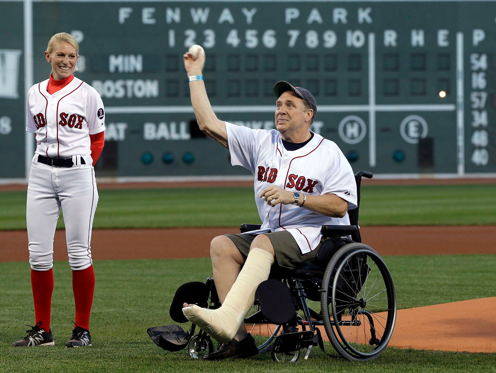 . Boston Marathon bombing victim Ron Brassard of Epsom, N.H., throws out a ceremonial first pitch prior to a baseball game between the Boston Red Sox and the Minnesota Twins at Fenway Park in Boston, Tuesday, May 7, 2013. (AP Photo/Elise Amendola)