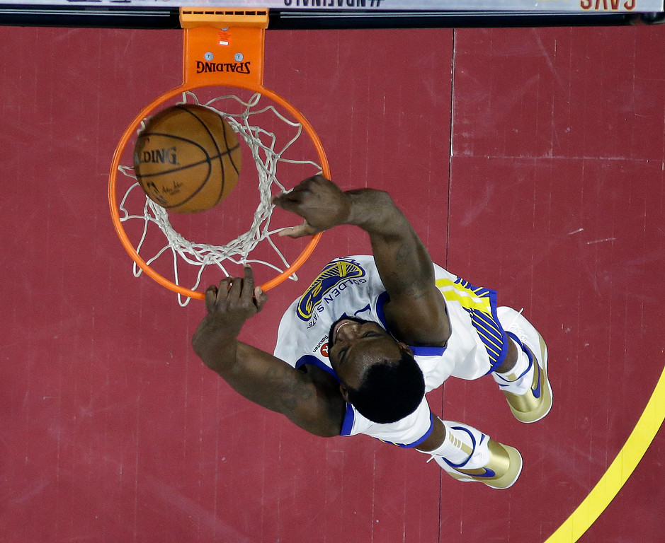 . Golden State Warriors\' Draymond Green dunks during the second half of Game 3 of basketball\'s NBA Finals against the Cleveland Cavaliers, Wednesday, June 6, 2018, in Cleveland. (AP Photo/Carlos Osorio, Pool)