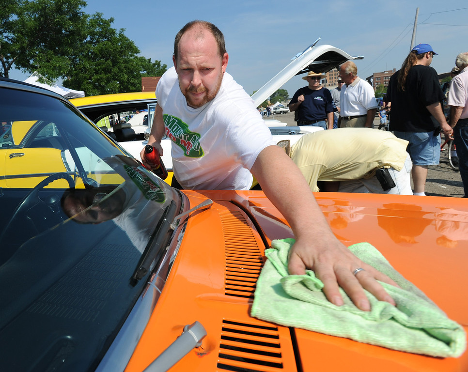 . John Vanderpool of Pontiac, Mich., shines his 1972 Chevy Nova in Lot 9, Saturday, August 15, 2009, in Pontiac, Mich.  (The Oakland Press/Jose Juarez)
