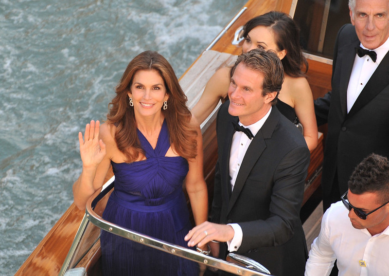 . Cindy Crawford and Rande Gerber wave from a boat as they go to George Clooney\'s wedding with Amal Alamuddin, in Venice, Italy, Saturday, Sept. 27, 2014. (AP Photo/Luigi Costantini)