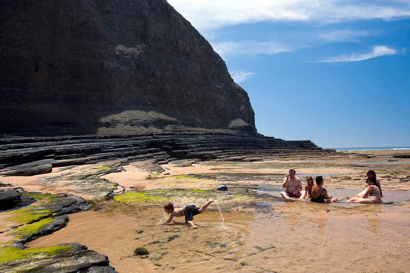 A family on Monte Clerigo beach, town of Aljezur, district of Faro, region of Algarve, southwestern Portugal
