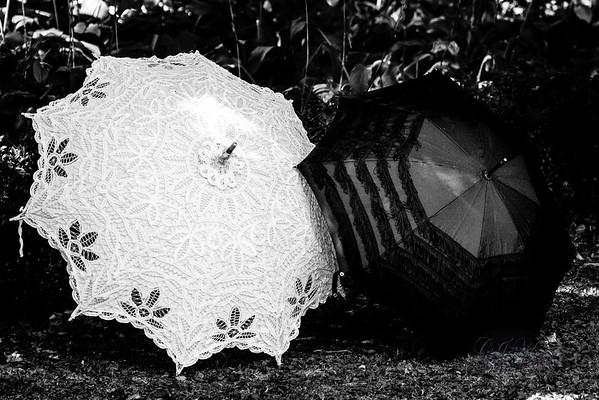 Two women and their parasols