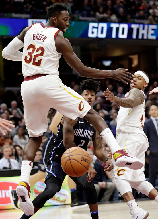 . Orlando Magic\'s Elfrid Payton (2) passes the ball against Cleveland Cavaliers\' Jeff Green (32) and Isaiah Thomas (3) during the second half of an NBA basketball game Thursday, Jan. 18, 2018, in Cleveland. The Cavaliers won 104-103. (AP Photo/Tony Dejak)