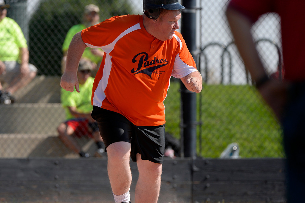 . DENVER, CO. - AUGUST 17:  Richard Schatz of the Colorado Springs Padres, heads for first base during the Special Olympics softball state championship at the Lowry Sports Complex in Denver, CO August 17, 2013. Special Olympics Colorado hosted its state championship in Bocce, Cycling, Golf, Softball and Tennis. Six hundred athletes competed in the events, which was supported by 250 volunteers and coaches. (Photo By Craig F. Walker / The Denver Post)