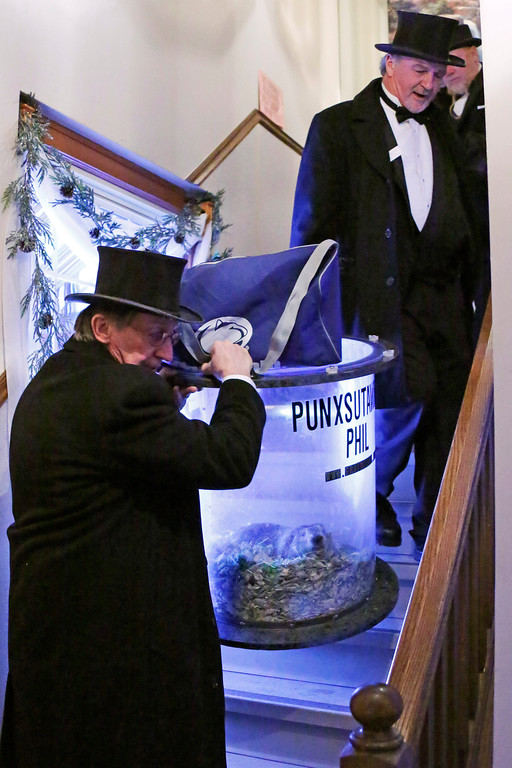 . Groundhog Club handlers John Griffiths, top right and Ron Ploucha, left, carry Punxsutawney Phil, the weather prognosticating groundhog, down a flight of stairs after attending a function on Groundhog Day eve in Punxsutawney, Pa. Wednesday, Feb. 1, 2017. The members of the Punxsutawney Groundhog Club\'s inner circle with make their trek to Gobber\'s Knob for the 131st time early Thursday morning. (AP Photo/Gene J. Puskar)