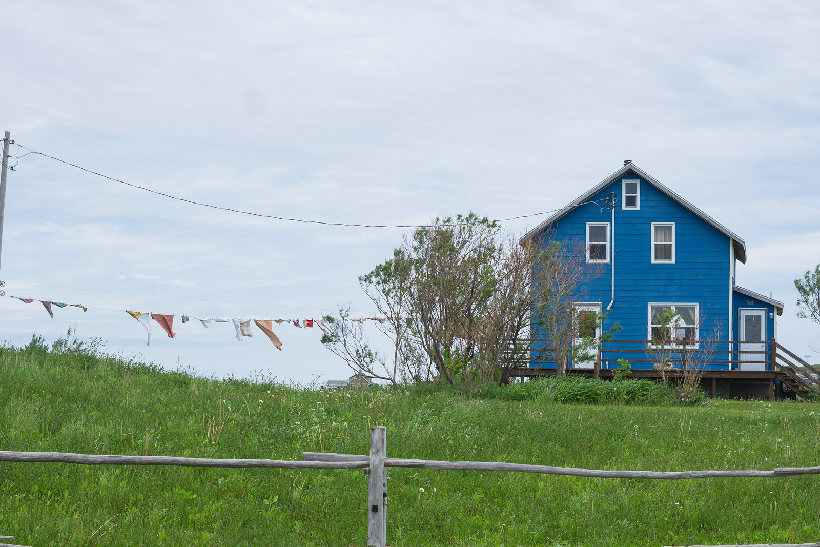 There is something inviting about a house with a line of clothing dancing in the wind. Loved this blue house in Fatima, Quebec.