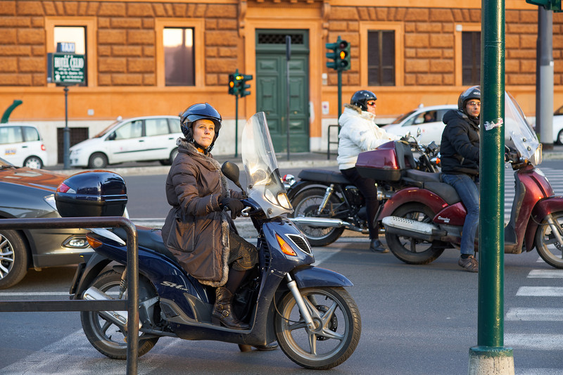 Woman on scooter, Rome, Italy, February 2009