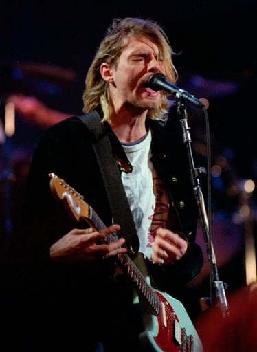 Description of . FILE - In this Dec. 13, 1993 file photo, Kurt Cobain, lead singer for the Seattle-based band Nirvana, performs during the taping of MTV's Live and Loud Production in Seattle. Nirvana, Linda Ronstadt, Peter Gabriel, Hall and Oates, and The Replacements are among first-time nominees to the Rock and Roll Hall of Fame. The hall of fame announced its annual list of nominees Wednesday morning, Oct. 16, 2013, and half the field of 16 were first-time nominees. (AP Photo/Robert Sorbo, File)