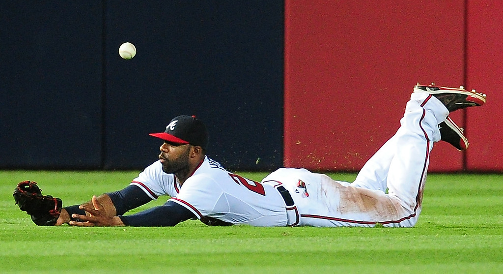 . Jason Heyward #22 of the Atlanta Braves is unable to make a catch in the ninth inning against the Colorado Rockies at Turner Field on July 30, 2013 in Atlanta, Georgia. (Photo by Scott Cunningham/Getty Images)