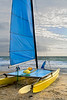 Small sailboat on shore getting ready to go out to sea.