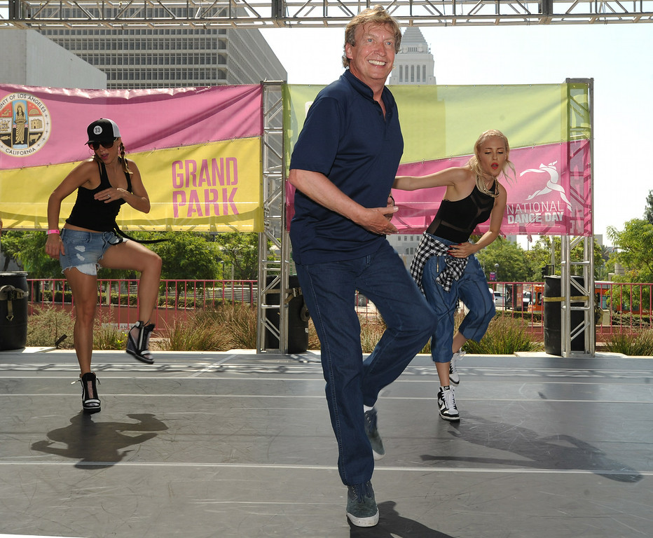 """. Nigel Lythgoe, co-creator and executive producer of \""""So You Think You Can Dance\"""" is joined by pop star,(right) Eden xo, and \""""So You Think You Can Dance\'s\"""" Ashley Valerio (left) to lead the 5th Annual National Dance Day celebration at Grand Park and The Music Center. More than 2,000 people participated in the free all-day dance extravaganza.  Los Angeles CA. 7/25/2014(Photo by John McCoy Daily News)"""