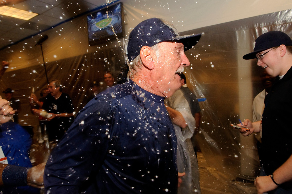 . MINNEAPOLIS, MN - SEPTEMBER 25: Torii Hunter #48 of the Detroit Tigers celebrates with champagne in the clubhouse after a win against the Minnesota Twins on September 25, 2013 at Target Field in Minneapolis, Minnesota. The Tigers clinched the American League Central Division title with a 1-0 win over the Twins. (Photo by Hannah Foslien/Getty Images)