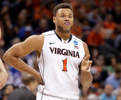 . Virginia\'s Justin Anderson (1) reacts after being called for a foul against Michigan State during the second half of an NCAA tournament college basketball game in the Round of 32 in Charlotte, N.C., Sunday, March 22, 2015. (AP Photo/Nell Redmond)