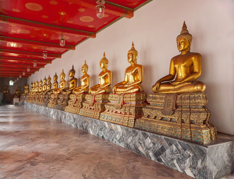 Row of Buddhas inside the Temple. Bangkok.