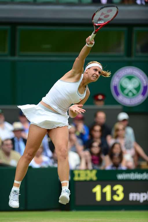 . Sabine Lisicki of Germany serves during her Ladies\' Singles fourth round match against Serena Williams of United States of America on day seven of the Wimbledon Lawn Tennis Championships at the All England Lawn Tennis and Croquet Club on July 1, 2013 in London, England.  (Photo by Mike Hewitt/Getty Images)