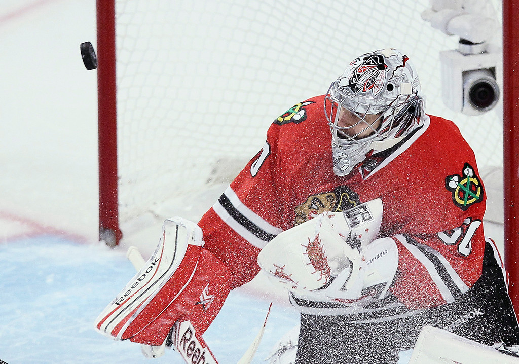. Corey Crawford #50 of the Chicago Blackhawks makes a save against the Los Angeles Kings in the second period of Game One of the Western Conference Final during the 2014 Stanley Cup Playoffs at United Center on May 18, 2014 in Chicago, Illinois.  (Photo by Tasos Katopodis/Getty Images)