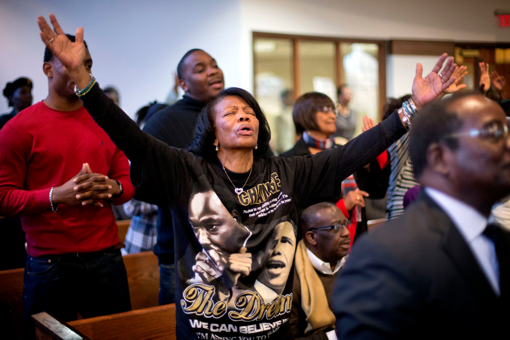 . Sheneal Davis, of McDonald, Ga., joins in a song during the annual Dr. Martin Luther King Jr. holiday service at the Ebenezer Baptist Church, Monday, Jan. 21, 2013, in Atlanta. The nation will honor civil rights leader Martin Luther King Jr. on Monday, the same day as it celebrates the inauguration of the first black president to his second term. (AP Photo/David Goldman)