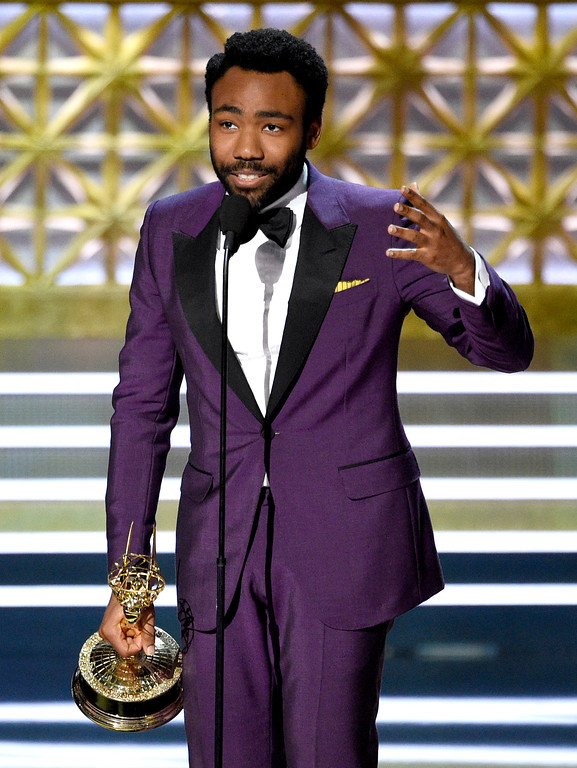 ". Donald Glover accepts the award for outstanding directing for a comedy series for the ""Atlanta\"" episode \""B.A.N.\"" at the 69th Primetime Emmy Awards on Sunday, Sept. 17, 2017, at the Microsoft Theater in Los Angeles. (Photo by Chris Pizzello/Invision/AP)"