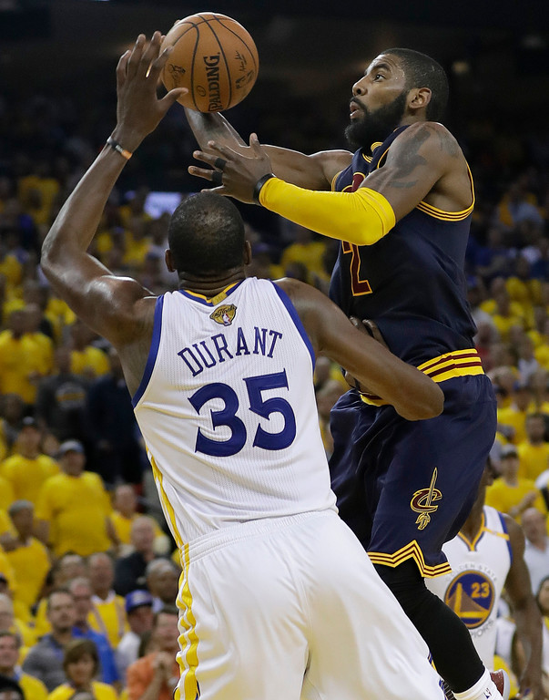 . Cleveland Cavaliers guard Kyrie Irving, left, shoots against Golden State Warriors forward Kevin Durant (35) during the second half of Game 1 of basketball\'s NBA Finals in Oakland, Calif., Thursday, June 1, 2017. (AP Photo/Marcio Jose Sanchez)