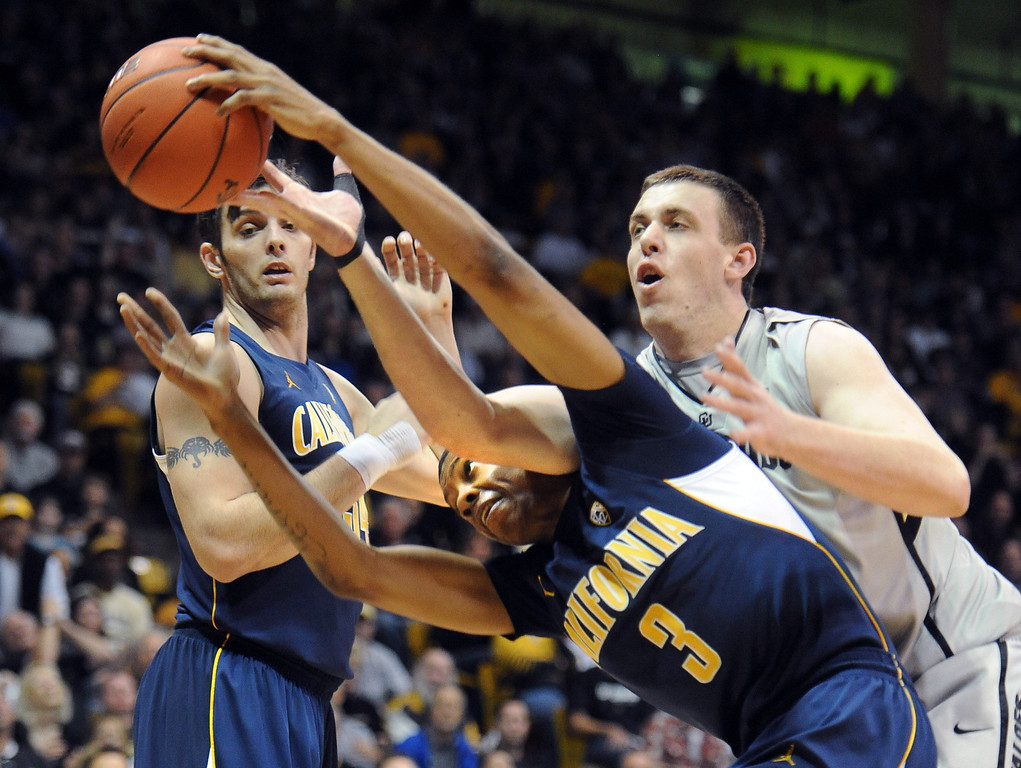. Shane Harris-Tunks of CU tries to reach through Tyrone Wallace of Cal during the first half of the January 27th, 2013 game in Boulder. Cliff Grassmick/The Daily Camera