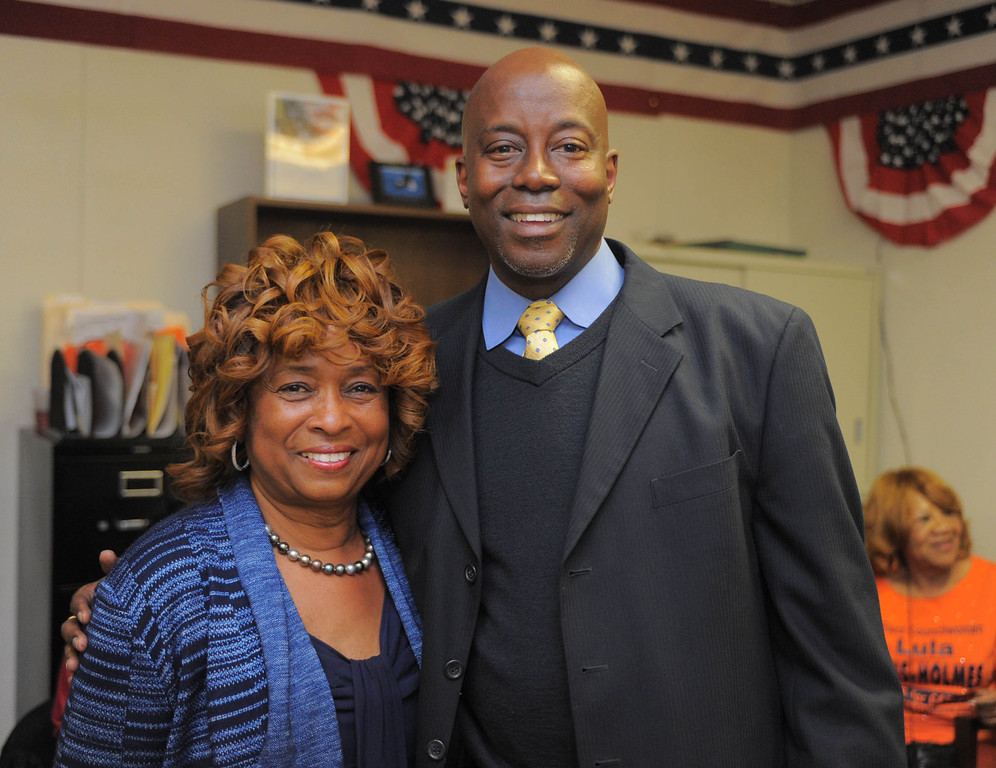 . an Hiller)- Carson Councilwoman Lula Davis-Holmes enjoys the atmosphere at her election night campaign headquarters as she and Mayor Jim Dear were in a tight race for mayor late Tuesday night in Carson.  She poses for a picture with Long Beach City Councilman Steven Neal.