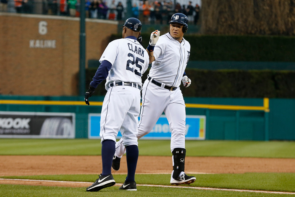 . Detroit Tigers\' Miguel Cabrera is congratulated by third base coach Dave Clark (25) after hitting a two-run home run against the Houston Astros in the first inning of a baseball game in Detroit Wednesday, May 7, 2014. (AP Photo/Paul Sancya)