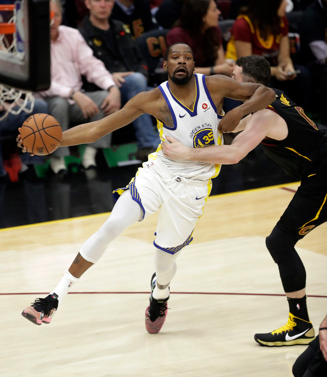 . Golden State Warriors\' Kevin Durant is fouled by Cleveland Cavaliers\' Kevin Love, right, during the first half of Game 3 of basketball\'s NBA Finals, Wednesday, June 6, 2018, in Cleveland. (AP Photo/Tony Dejak)