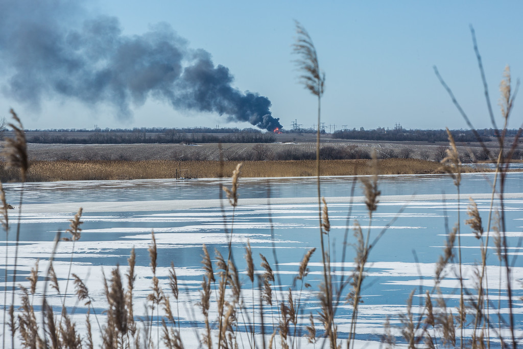 . MYRONIVSKYI, UKRAINE - FEBRUARY 17: A gas pipe burns in the distance after being struck by shelling on February 17, 2015 in Myronivskyi, Ukraine. A ceasefire agreed to by Ukraine and pro-Russian rebel forces has failed to prevent fighting in the nearby town of Debaltseve, where thousands of Ukrainian troops remain and whom rebels claim to have surrounded. (Photo by Brendan Hoffman/Getty Images)