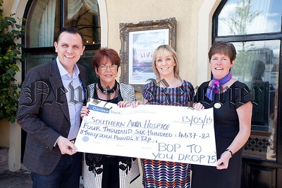 Lisa Mulkearns from Southern Area Hospice accepts a cheque for £4637.82 from Miceal Magill, Susan McCann and Louise Young the proceeds of Bop To You Drop which took place i teh Canal Court Hotel recently. R1521003