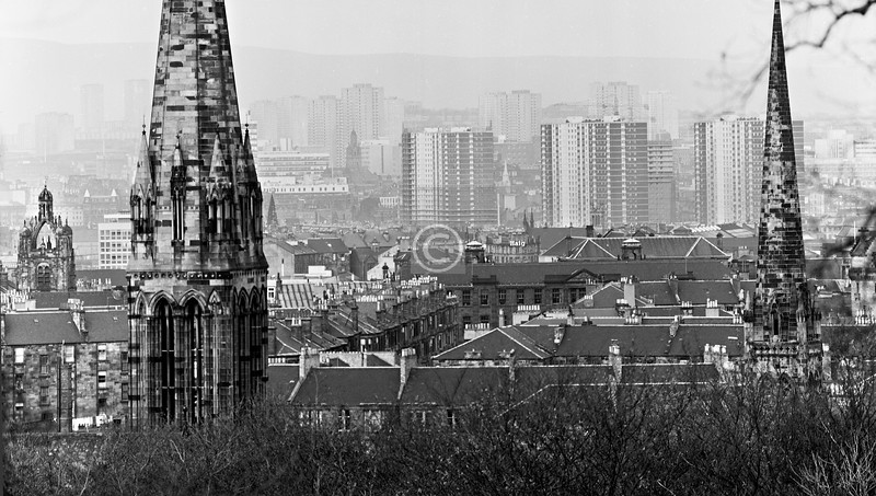 A view north-east from somewhere in the Queen's Park, not from the flagpole mound I think but a bit to the north-west of it, looking mostly between the steeples of QP Baptist and QP West churches. 1976