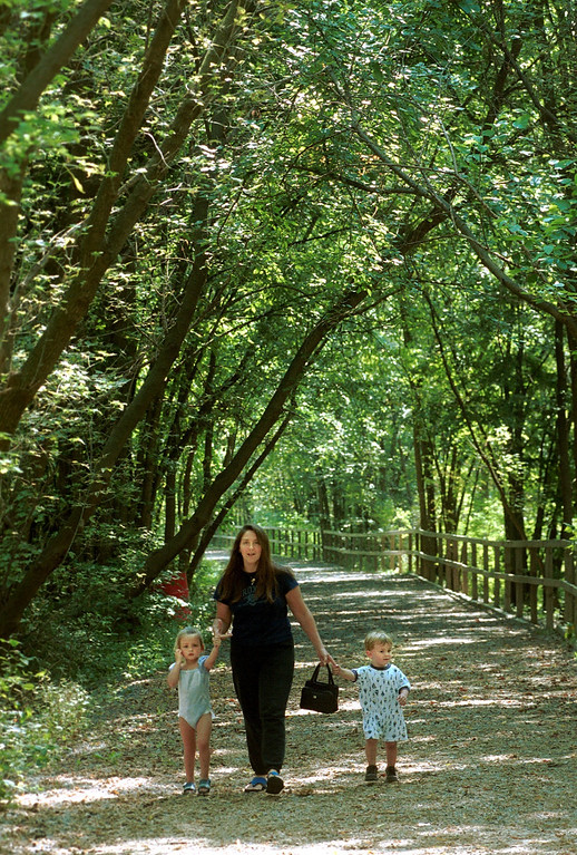 . Jonna Foeller, of Rochester, walks with her children, Brenna (left), 3, and Richard, 2, at the hiking trail at Yates Cider Mill in Rochester Hills Friday.