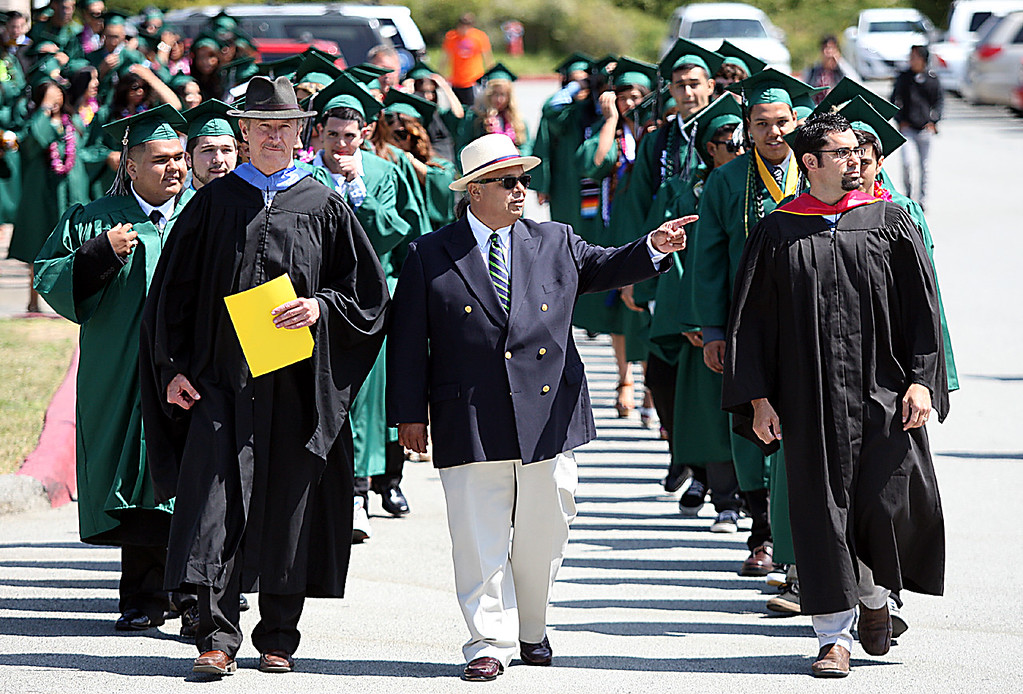 . Pajaro Valley High Principal Pancho Rodriguez leads the procession of graduates and faculty Thursday at Cabrillo college.  (Dan Coyro/Sentinel)