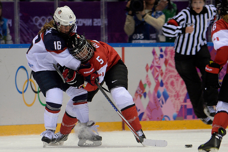 . Lauriane Rougeau (5) of the Canada checks Kelli Stack (16) of the U.S.A. during the second period of the women\'s gold medal ice hockey game. Sochi 2014 Winter Olympics on Thursday, February 20, 2014 at Bolshoy Ice Arena. (Photo by AAron Ontiveroz/ The Denver Post)