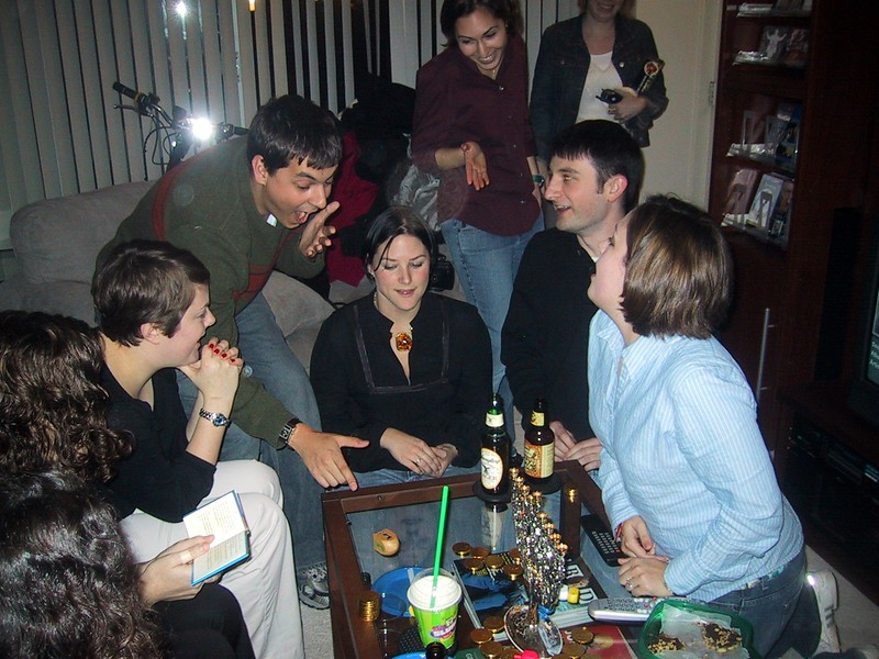 Guests enjoy a lively game of dreidel