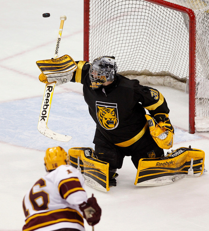. Colorado College goalie Joe Howe (31) makes a save against Minnesota\'s Nate Condon (16) in the second period of a WCHA Final Five semifinal college hockey game Friday, March 22, 2013, in St. Paul, Minn. Colorado College won 2-0. (AP Photo/Genevieve Ross)
