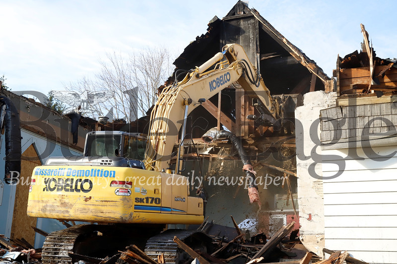 An excavator from Massarelli Demolition tears down St. Matthias Catholic Church Thursday in Evans City. The closed church caught fire earlier this year causing significant damage to the structure. Seb Foltz/Butler Eagle