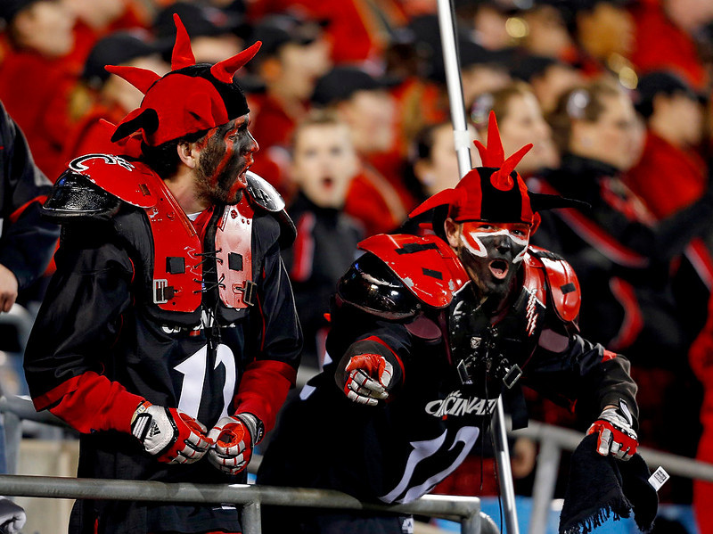 . Cincinnati fans cheer during the first half of the Belk Bowl NCAA college football game against Duke in Charlotte, N.C., Thursday, Dec. 27, 2012. (AP Photo/Chuck Burton)