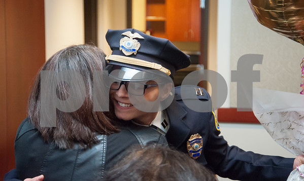 02/15/18 Wesley Bunnell | Staff The New Britain Police Department promoted three of its own including the first female captain in its history. Newly promoted Captain Jeanette Portalatin holds balloons as she hugs family members at the conclusion of the ceremony.