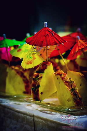 A forest of pineapple umbrella garnish. © 2012 Sugar + Shake