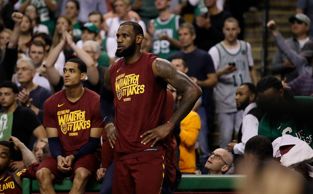 . Cleveland Cavaliers guard Jordan Clarkson, left, and forward LeBron James watch from the sideline during the second half in Game 2 of the NBA basketball Eastern Conference finals against the Boston Celtics, Tuesday, May 15, 2018, in Boston. (AP Photo/Charles Krupa)