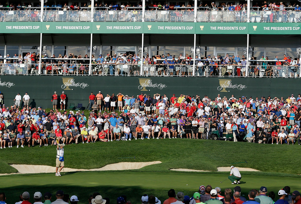 . International\'s Louis Oosthuizen, right, of South Africa, reacts to a missed putt on the 14th green during a four-ball match at the Presidents Cup golf tournament at Muirfield Village Golf Club Thursday, Oct. 3, 2013, in Dublin, Ohio. (AP Photo/Darron Cummings)
