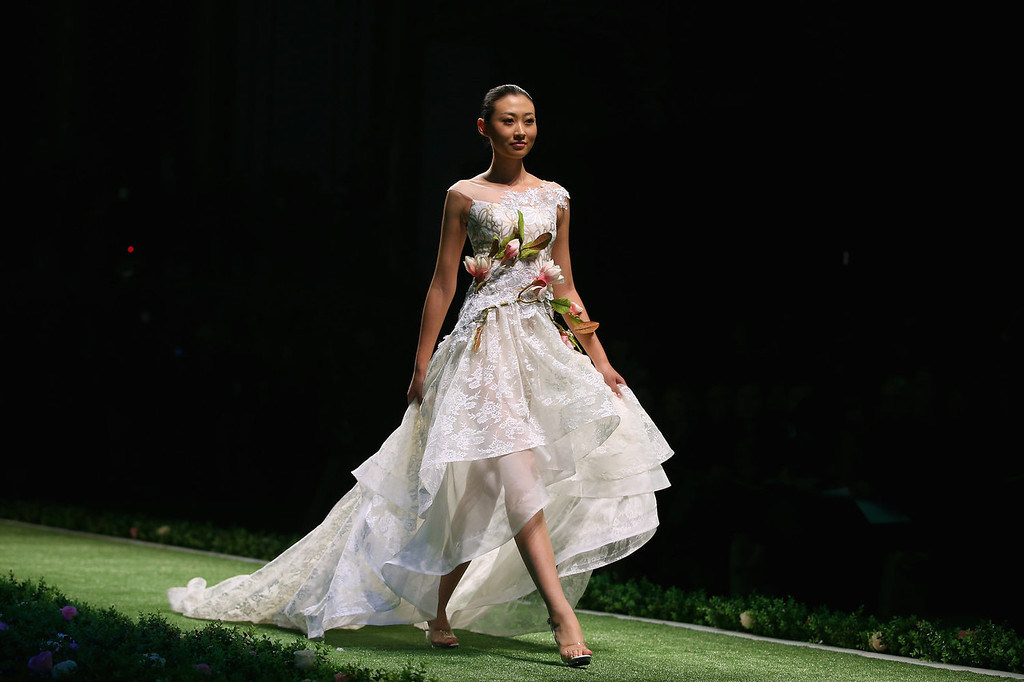 . A model showcases designs by Taiwanese designer Tsai Meiyue on the runway at Tsai Meiyue Wedding Dress Collection show during Mercedes-Benz China Fashion Week Spring/Summer 2014 at Beijing Hotel on October 27, 2013 in Beijing, China.  (Photo by Feng Li/Getty Images)